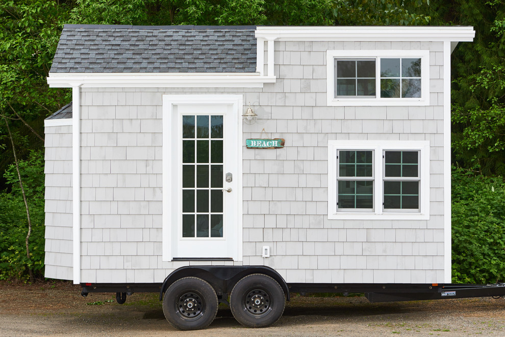 Beach style gray two-story wood gable roof photo in Portland