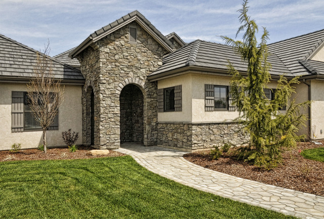 Beautiful home featuring italian villa stone coronado Stone products for home exterior