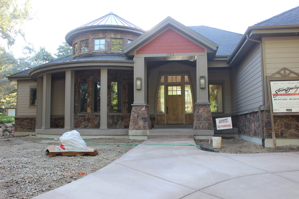 Example of a large classic gray two-story mixed siding exterior home design in Salt Lake City