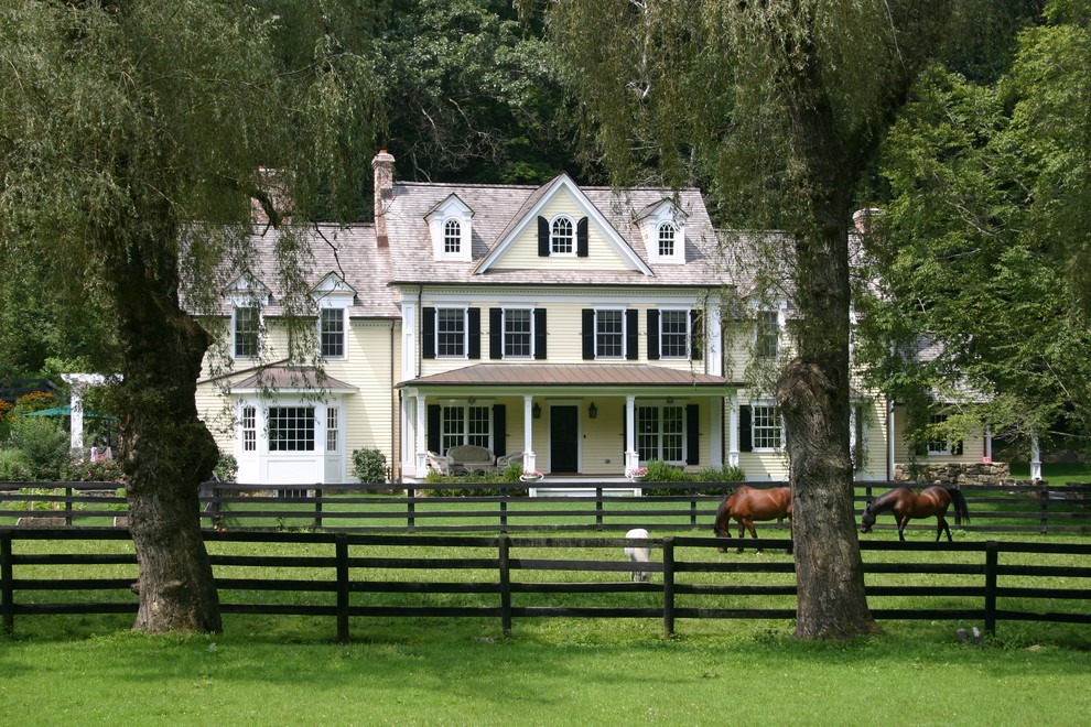 Example of a cottage wood exterior home design in New York