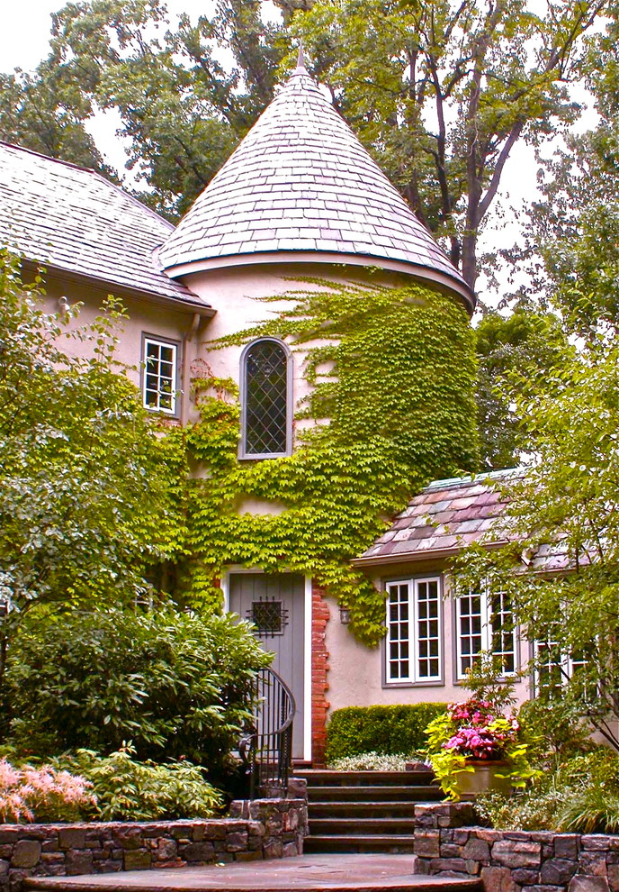 Traditional pink two-story exterior home idea in New York