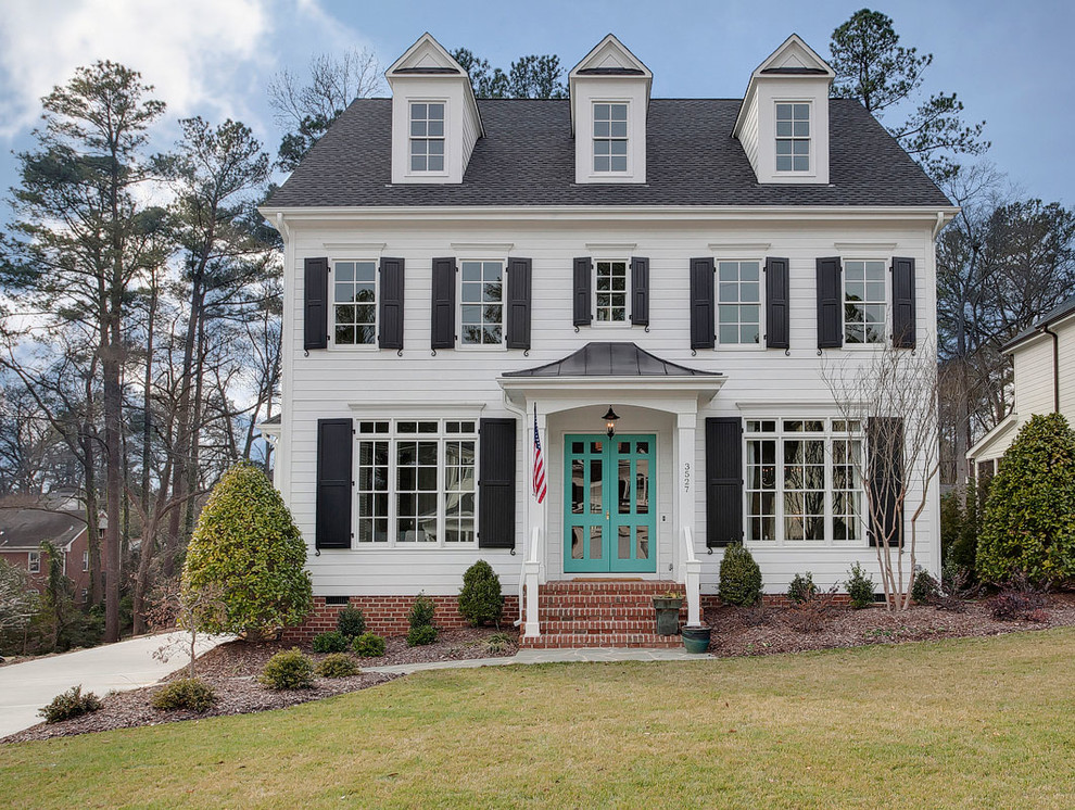 Example of a classic white two-story exterior home design in Raleigh