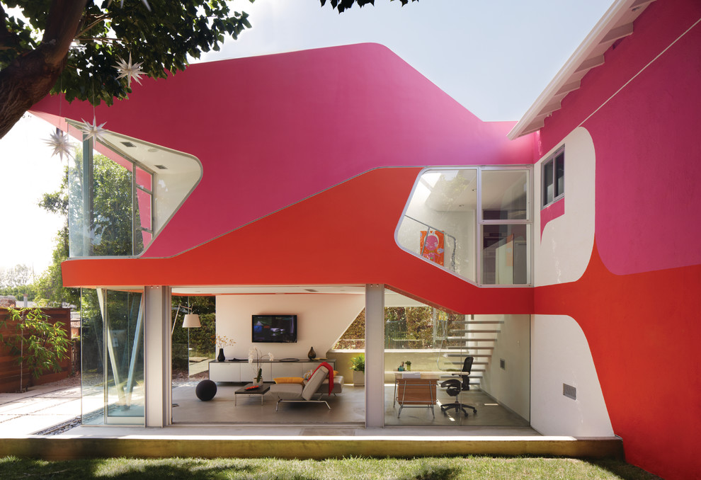 Inspiration for a contemporary pink exterior home remodel in Los Angeles
