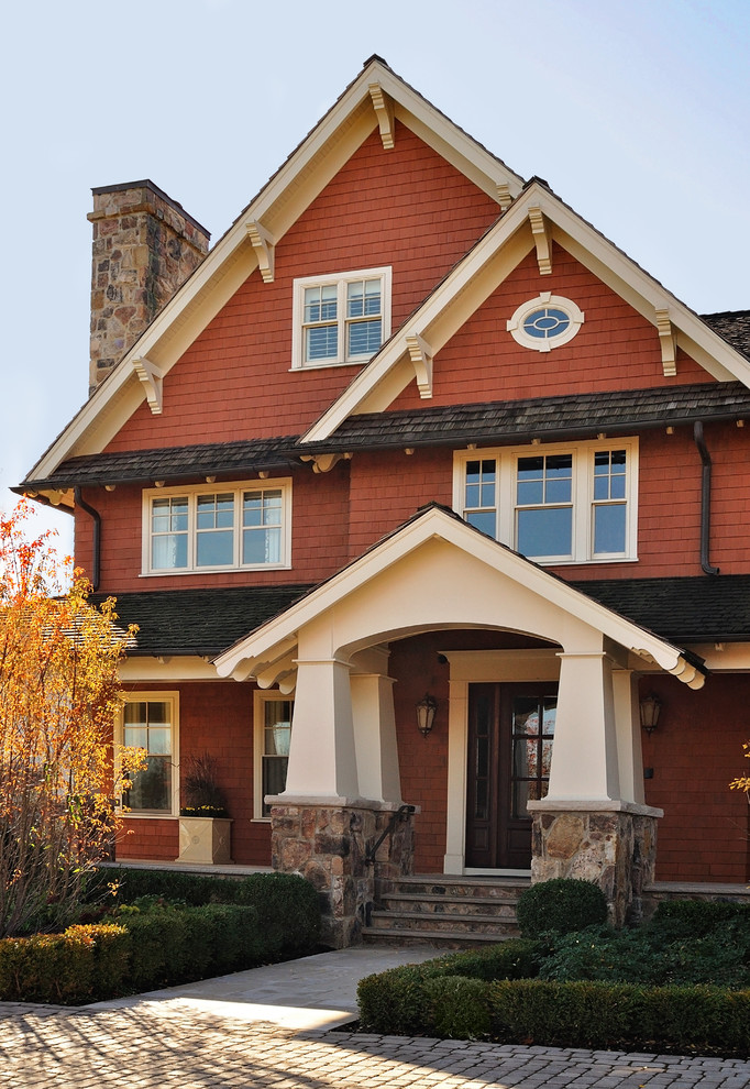 Large arts and crafts brown three-story wood gable roof photo in New York