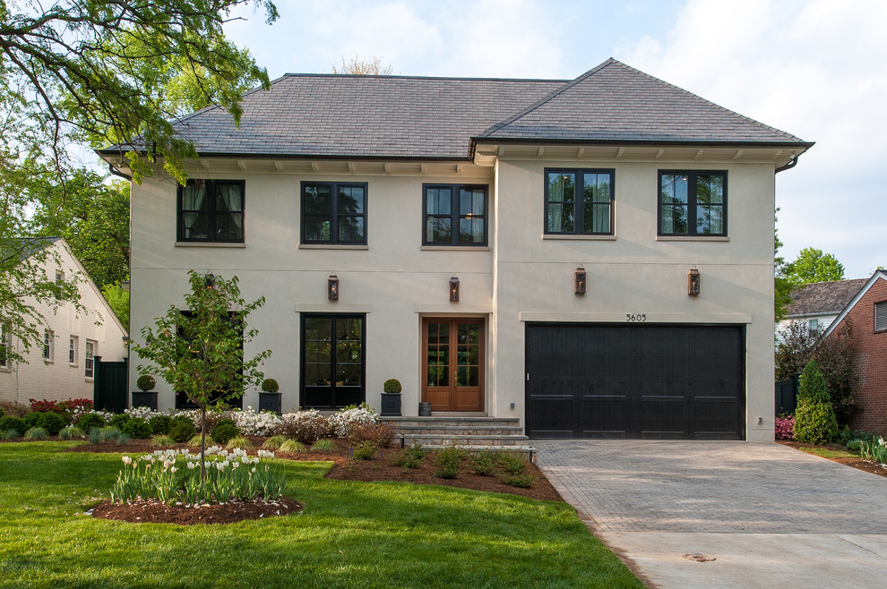 Large transitional beige three-story stucco house exterior idea in DC Metro with a hip roof and a shingle roof