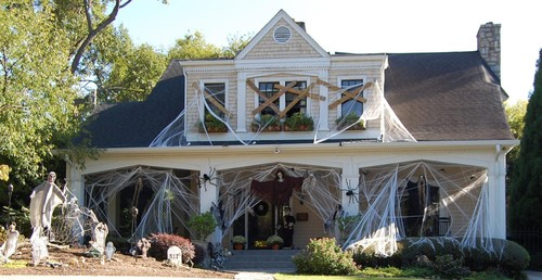house decorated with cobwebs and other Halloween decor