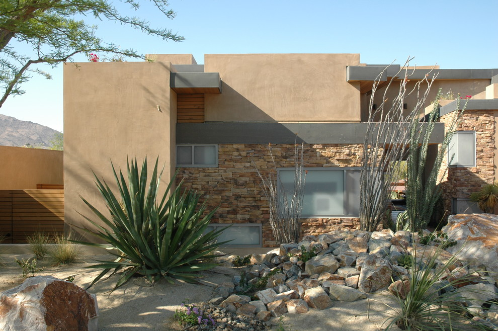 Example of a minimalist stone exterior home design in Los Angeles