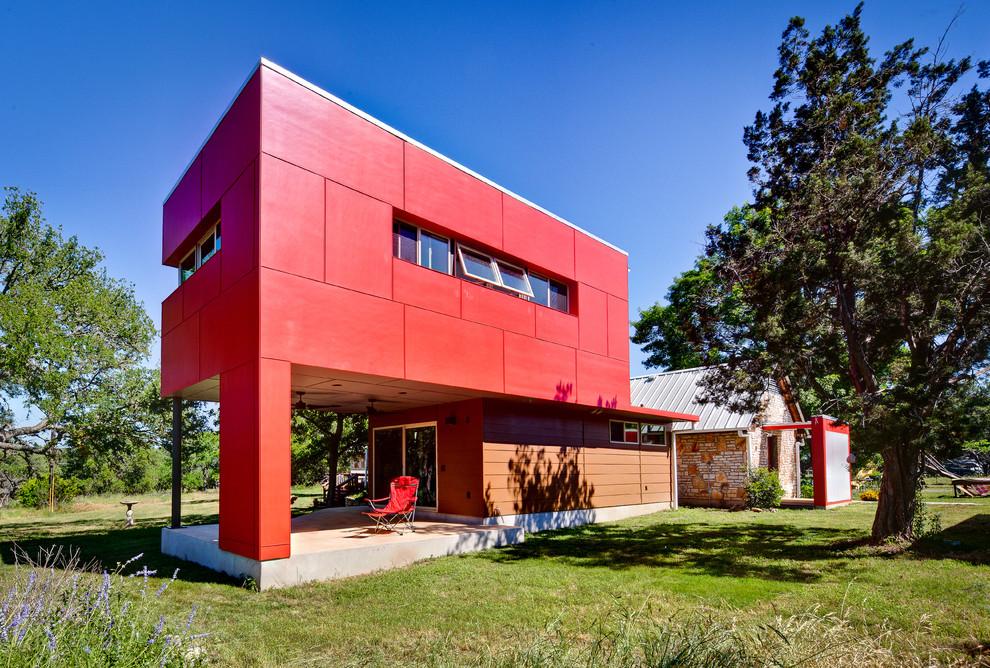 Contemporary red exterior home idea in Austin