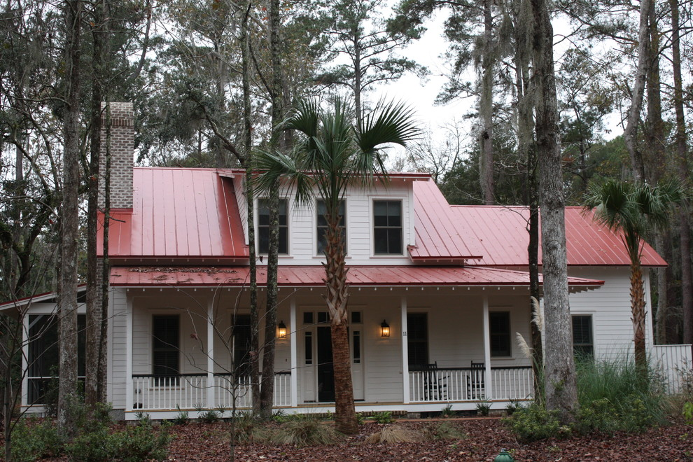 Inspiration for a mid-sized timeless white two-story wood gable roof remodel in Charleston