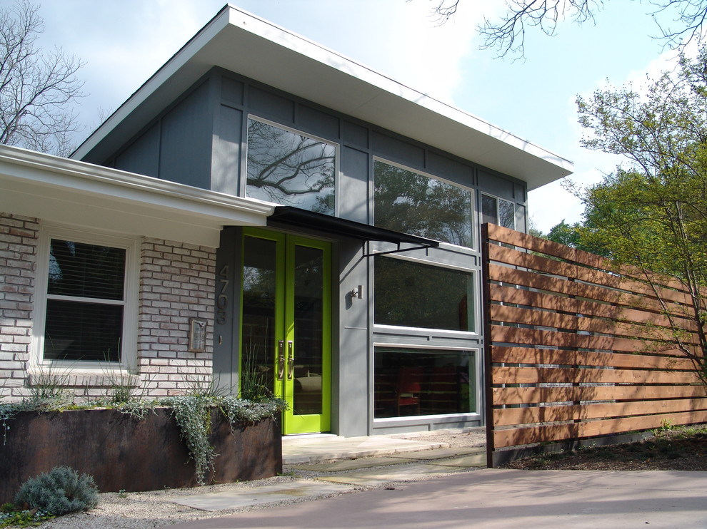 Example of a trendy one-story brick exterior home design in Austin