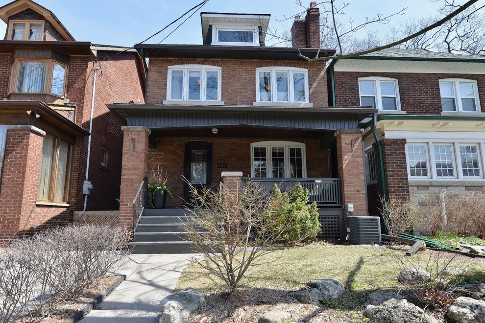 Mid-sized transitional multicolored two-story brick exterior home photo in Toronto with a shingle roof