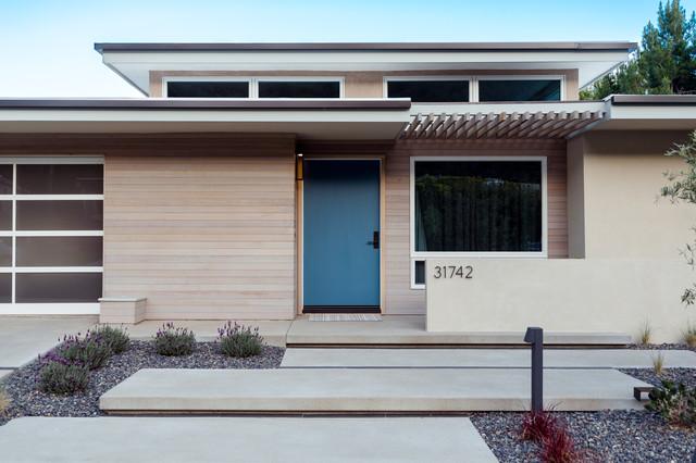 blue door at midcentury modern update midcentury