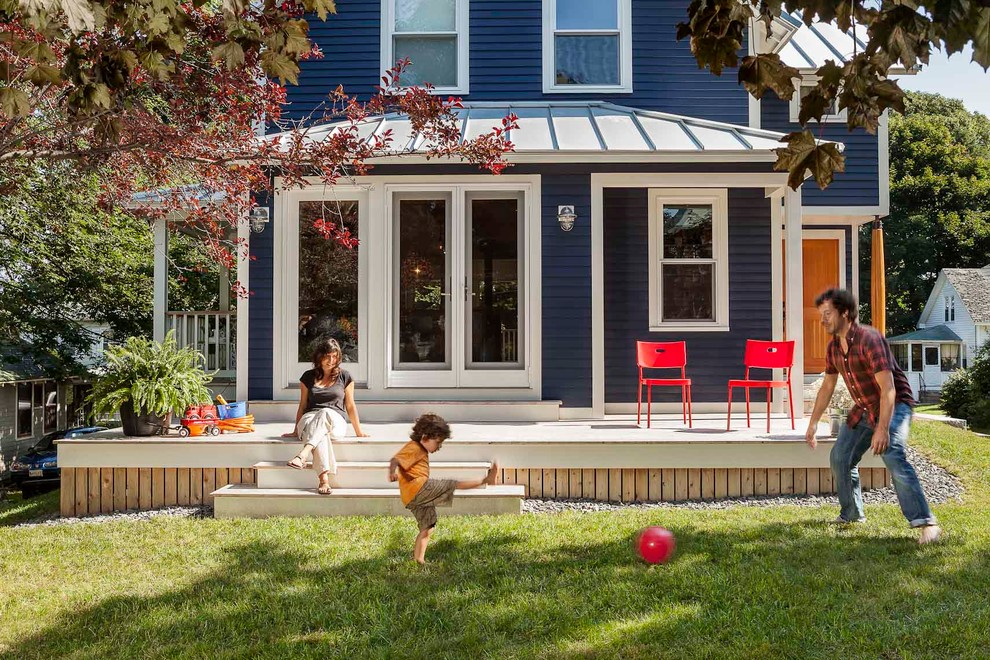 Example of a classic blue exterior home design in Portland Maine