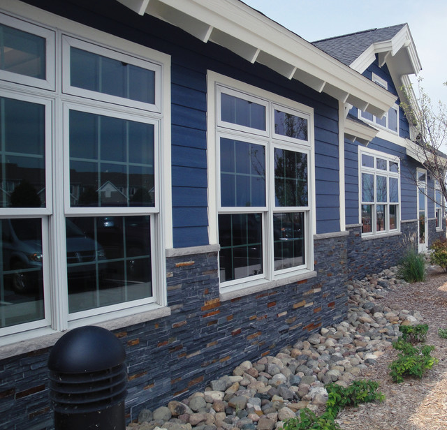 blue siding with natural split stone american traditional