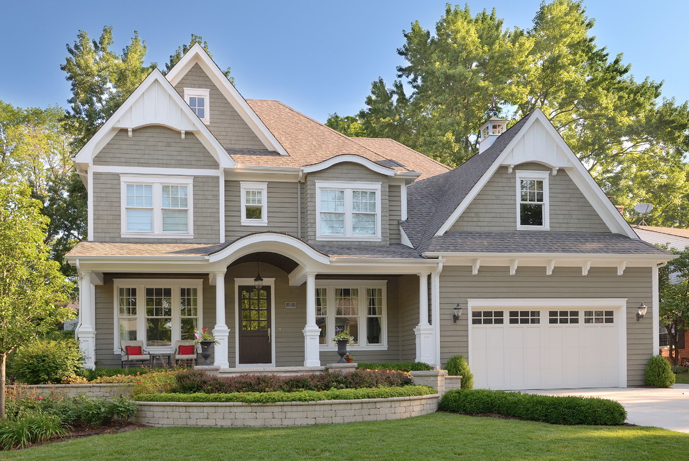 Inspiration for a timeless gray two-story wood exterior home remodel in Chicago