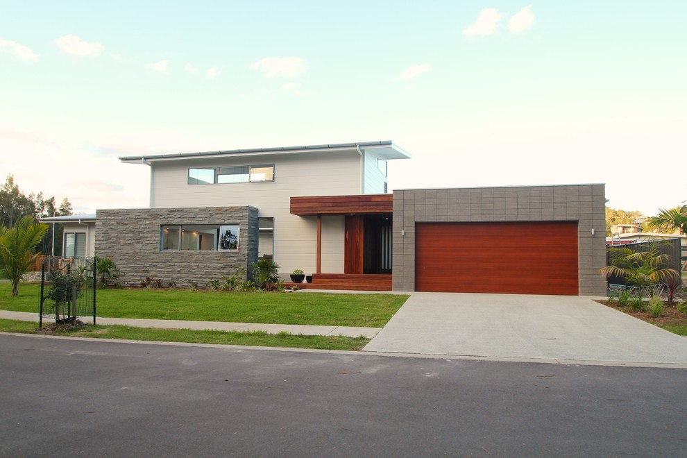 This is an example of a large contemporary two-storey exterior in Sydney.