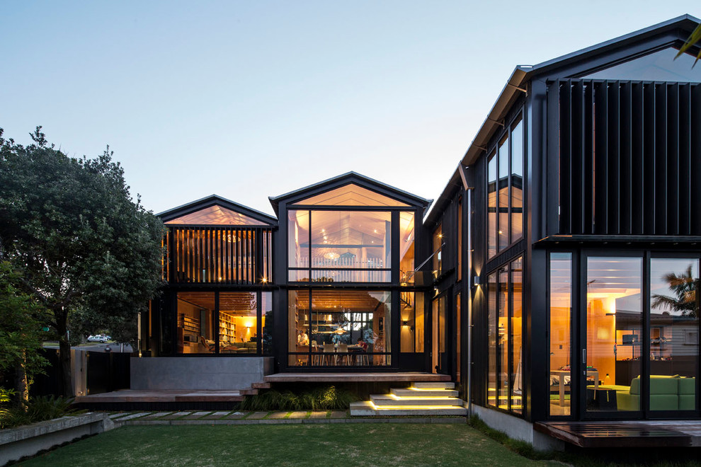 Contemporary two-story glass exterior home idea in Napier-Hastings