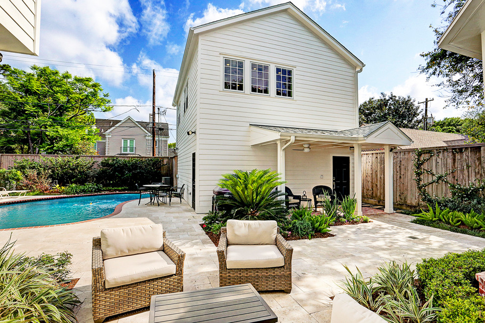 Inspiration for a mid-sized transitional white two-story wood exterior home remodel in Houston with a shingle roof