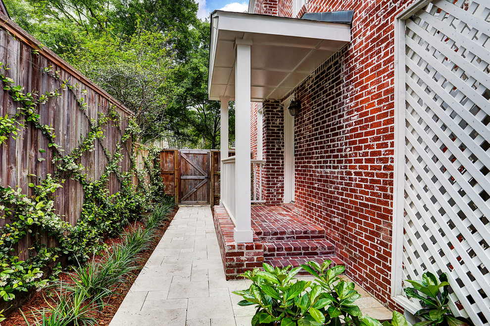Inspiration for a mid-sized transitional two-story brick house exterior remodel in Houston