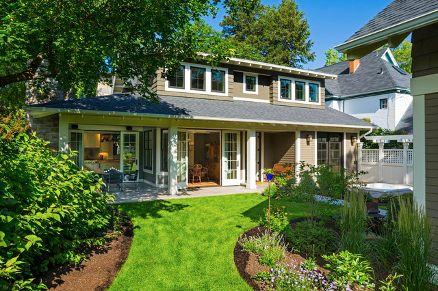 Example Of A Classic Wood Exterior Home Design In Other