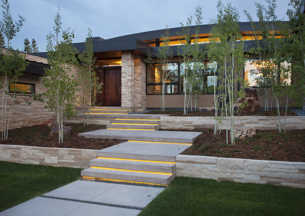 Inspiration for a contemporary two-story exterior home remodel in Denver