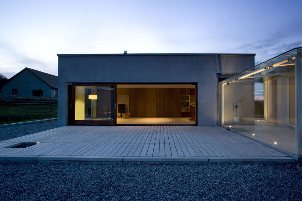 Example of a minimalist one-story exterior home design in Dublin