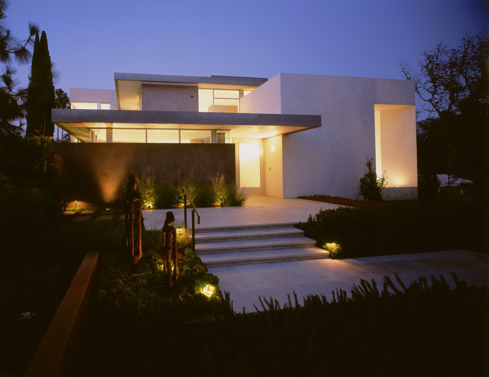 Large modern two-story flat roof idea in Los Angeles