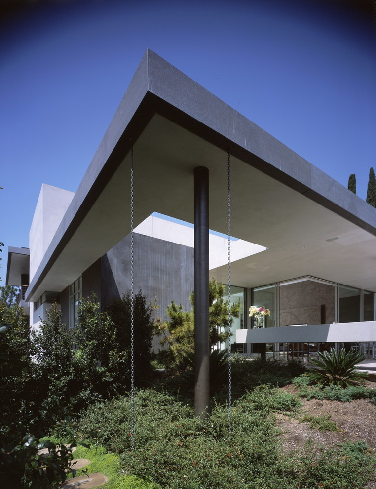 Inspiration for a modern stucco exterior home remodel in Los Angeles