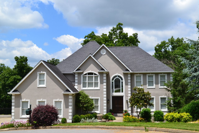 Example of a classic beige two-story exterior home design in Other