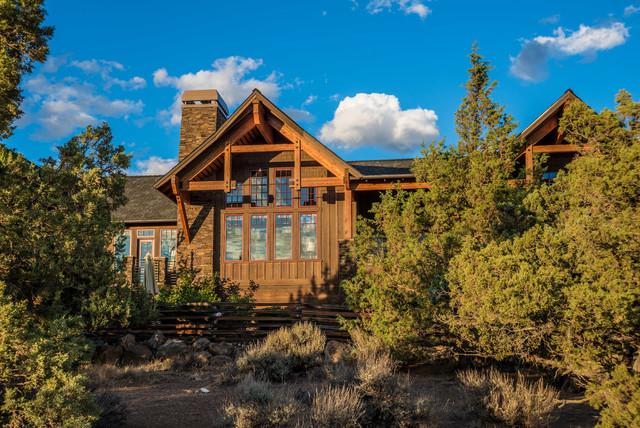 Brasada Ranch home rear exterior showing living room windows rustic-exterior
