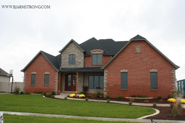 Brick and stone home exterior traditional exterior for Traditional brick homes