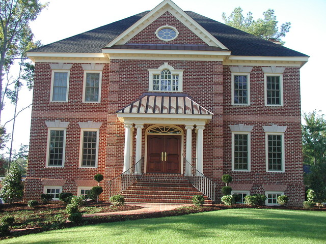 Brick colonial with basement garage traditional exterior