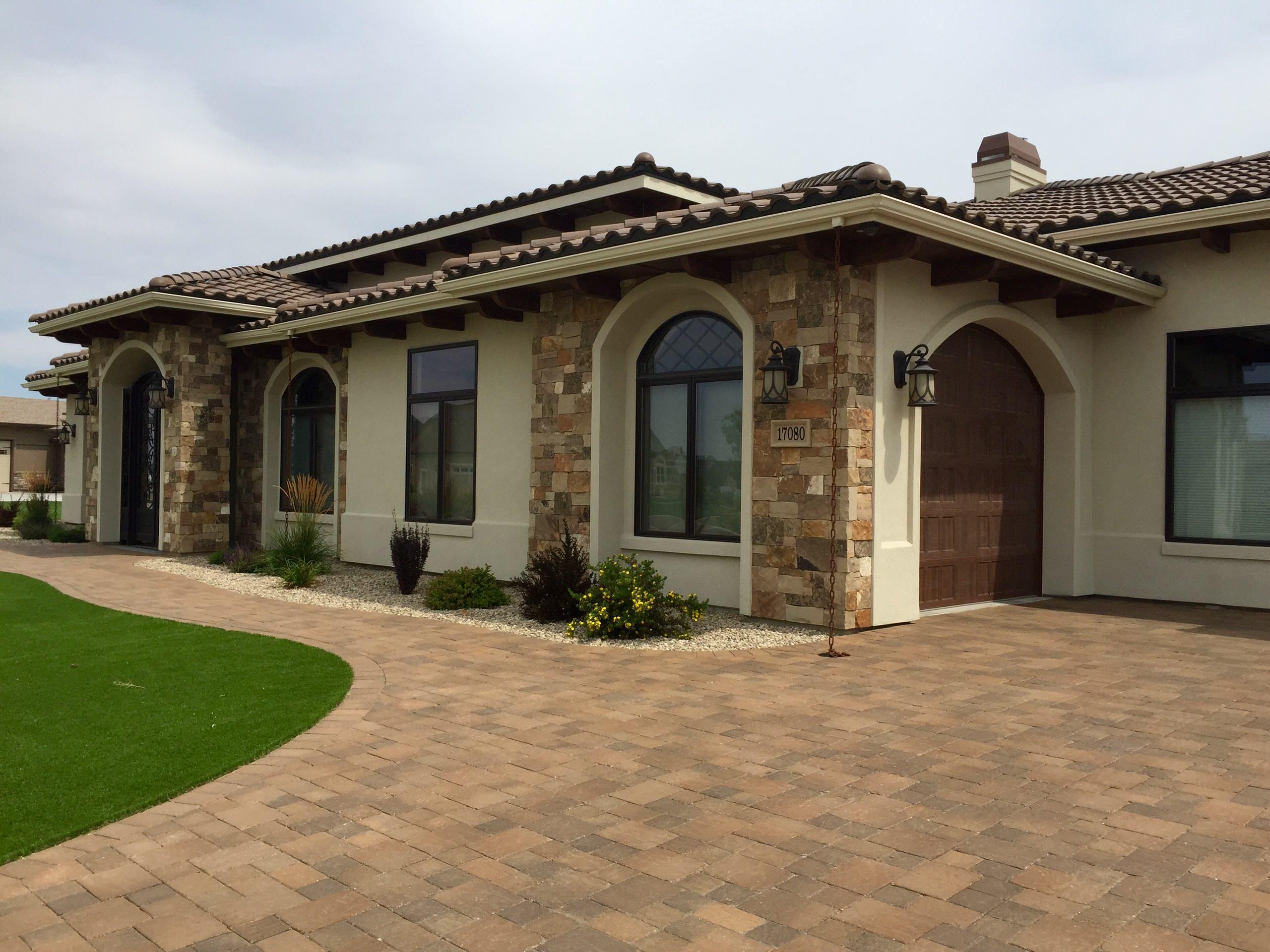 Brick Floor Home Design by Cotner Home Building