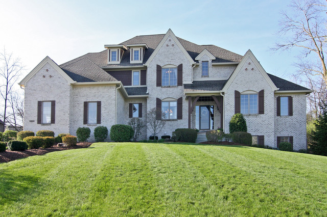 Brick french country home traditional exterior for French country brick exterior
