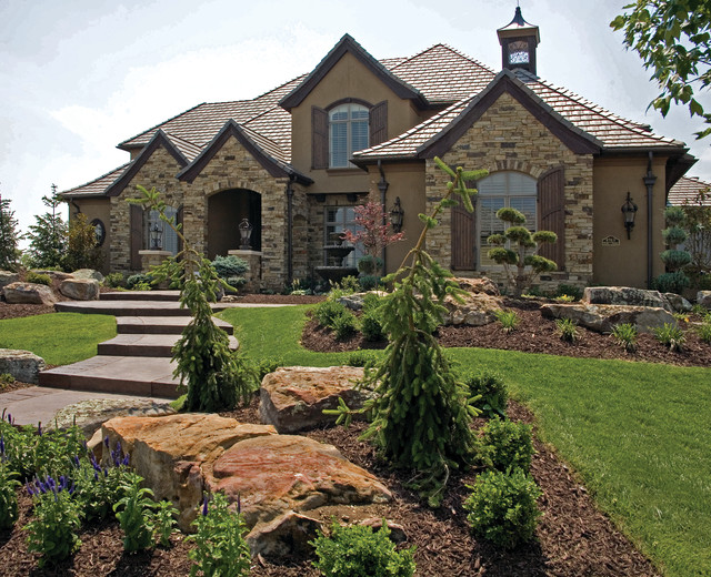 Brick rock stone we have the materials to make your for Exterior stone design houses