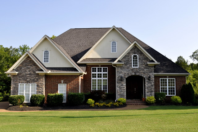 Brick stone and dryvit exterior in traditional colors for Stone and brick home designs