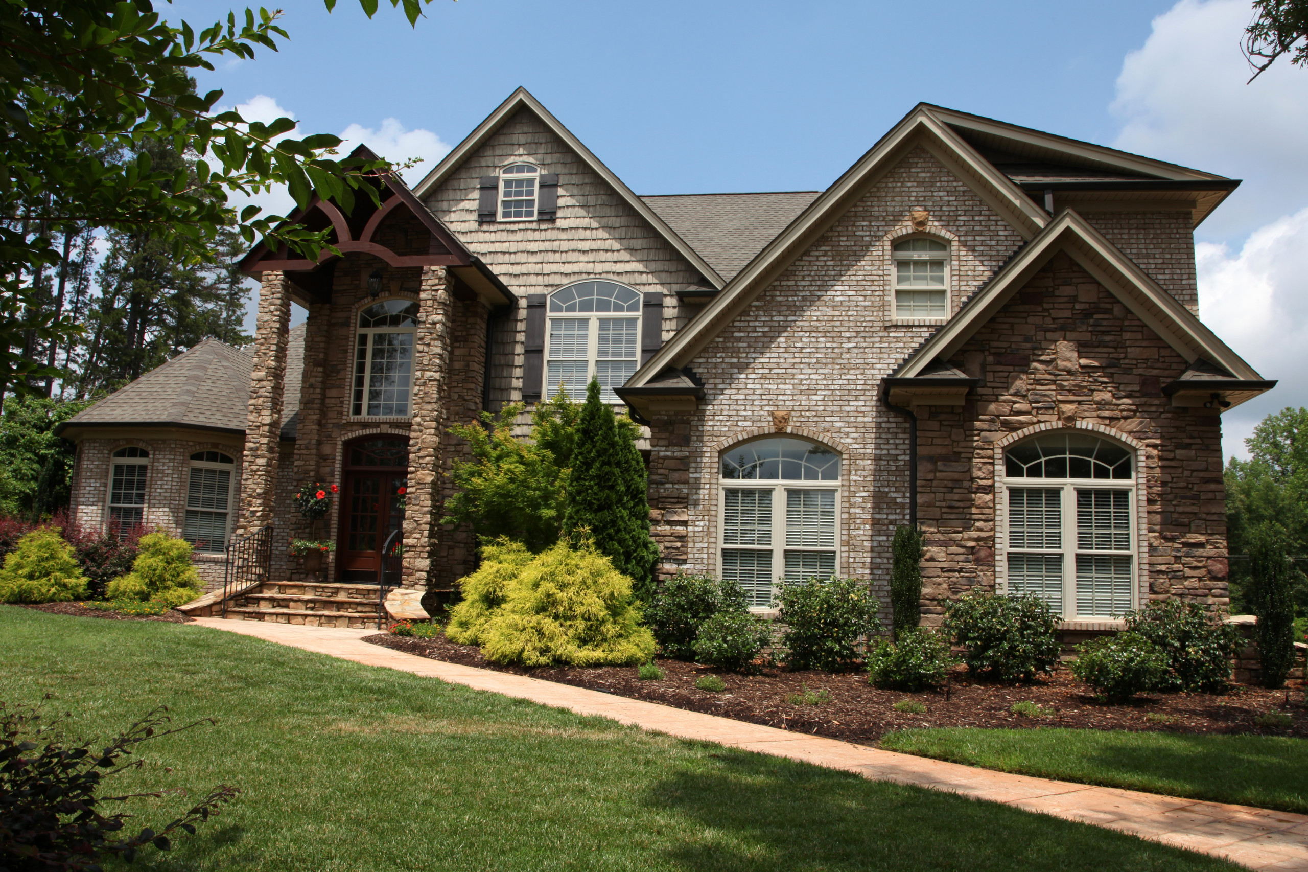 Brick Stone and Siding French Country Timberframe Porch