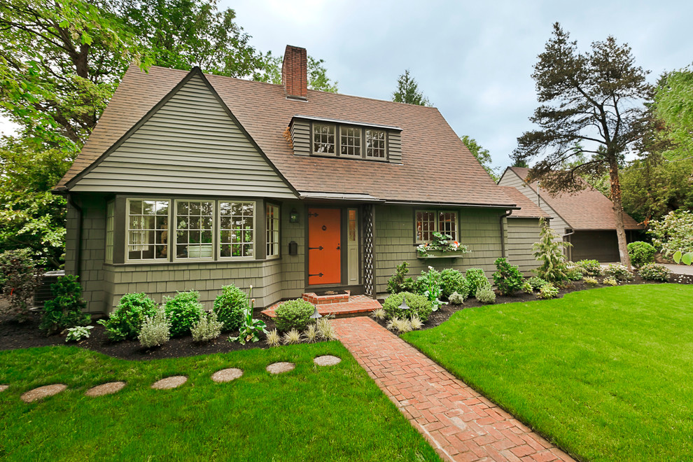 Mid-sized elegant green two-story wood gable roof photo in Portland