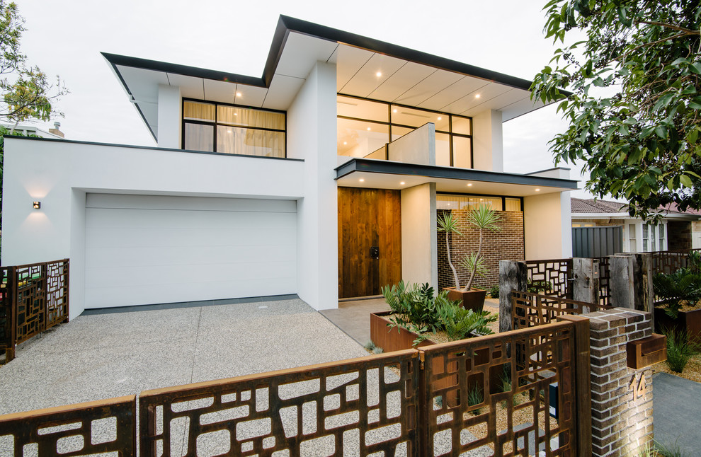 Example of a large trendy white two-story mixed siding flat roof design in Adelaide