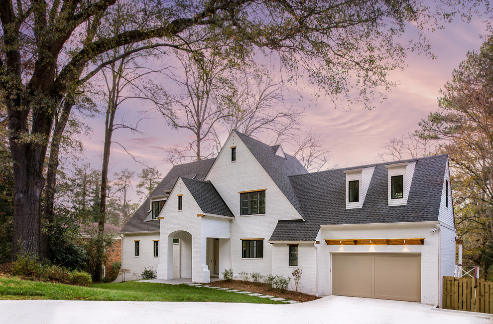 Large transitional white two-story brick exterior home photo in Atlanta with a shingle roof
