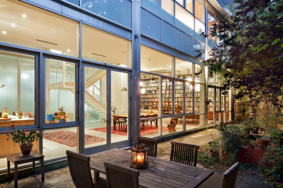 Example of an urban glass exterior home design in New York