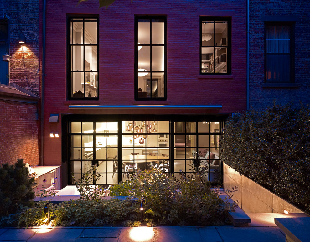 Inspiration for a contemporary brick exterior home remodel in New York