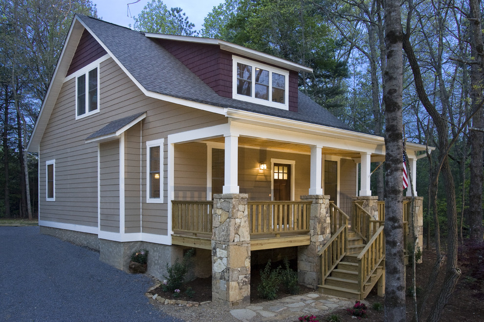 Arts and crafts stone exterior home photo in Other