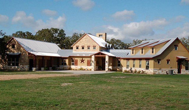 Burton hill country style rustic exterior houston for Hill country style homes