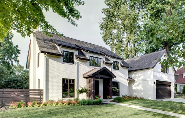 Butler tarkington modern tudor craftsman exterior for Modern tudor house