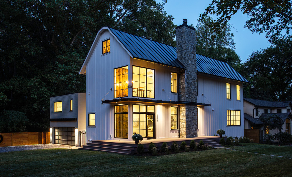 Transitional white two-story house exterior photo in DC Metro with a metal roof
