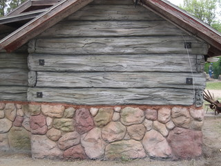 Cabin refacing siding with hand carved faux wood and stone - The wood cabin on the rocks ...