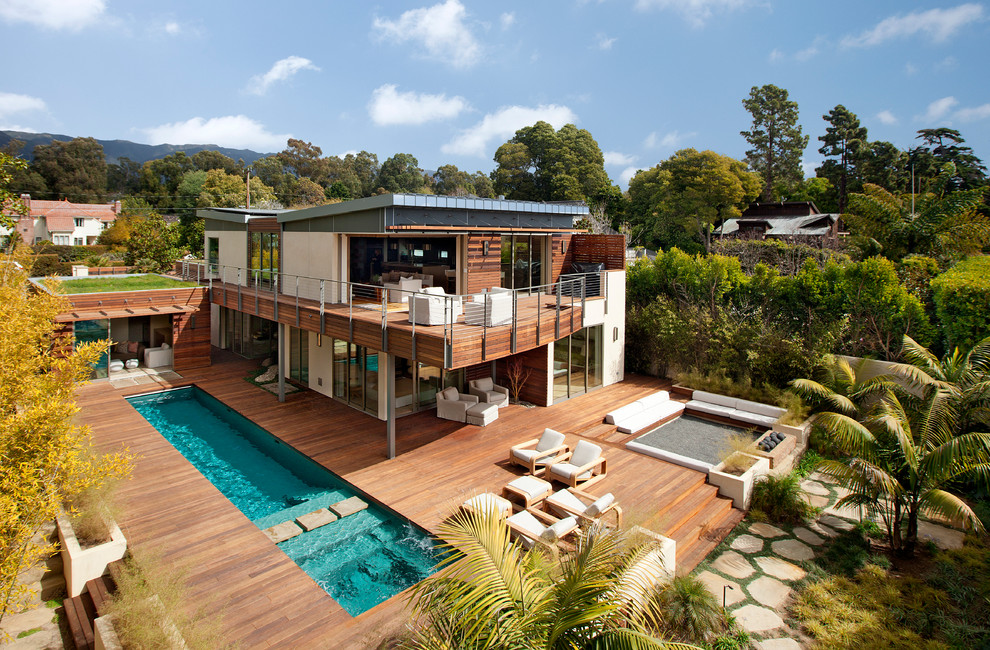 Mid-sized trendy white two-story mixed siding exterior home photo in Santa Barbara with a shed roof