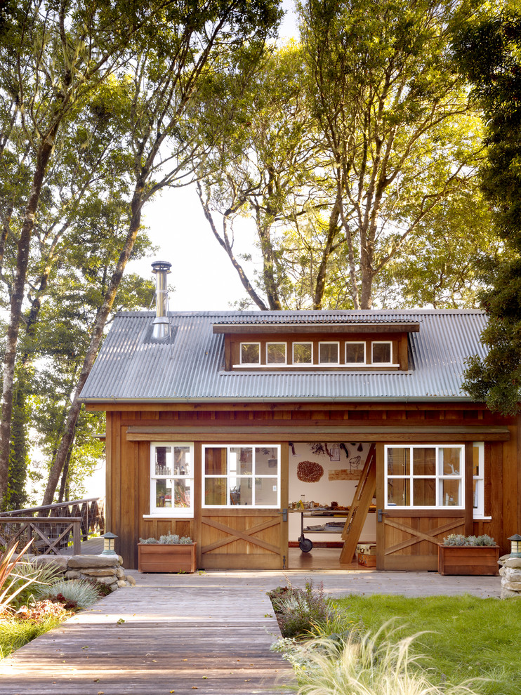 Inspiration for a rustic one-story wood gable roof remodel in San Francisco