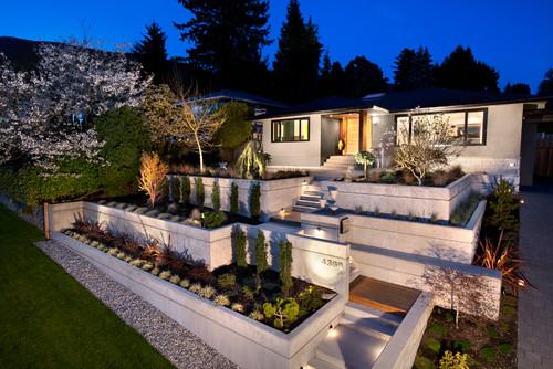 Landscape lighting ideas. Photo credit: Midcentury Exterior by Vancouver Design-Build Firms CCI Renovations